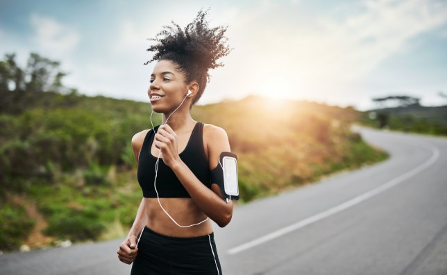 Shot of a sporty young woman running outdoors