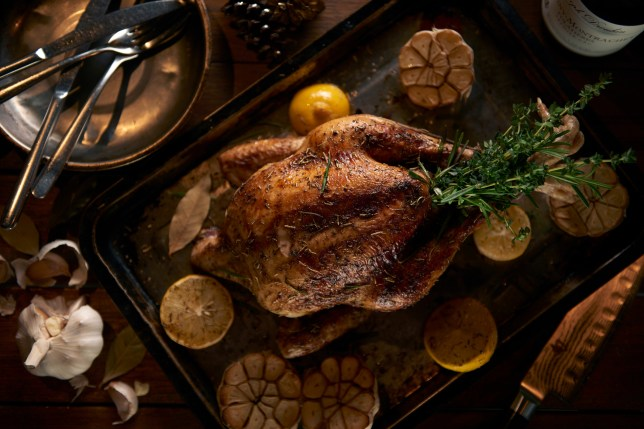 A cooked turkey served with herbs and spices.