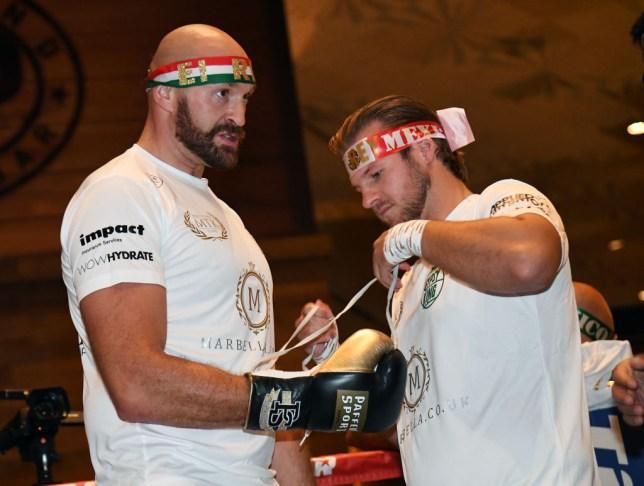 Tyson Fury has his gloves tied by trainer Ben Davison