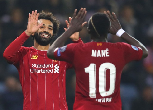 Mohamed Salah celebrates with Sadio Mane after scoring a goal for Liverpool