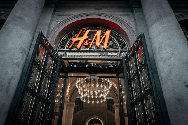 The H&M logo on the front door of a shop, the Swedish chain of clothing and accessories