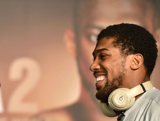 Heavyweight Anthony Joshua grins during a press conference