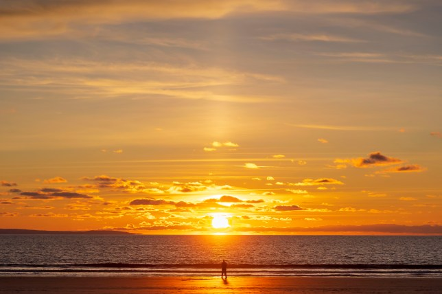 A man silhouetted by the sun during sunset at Southerndown beach on November 18.