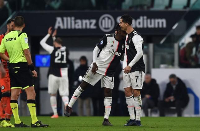Cristiano Ronaldo gives Blaise Matuidi a hug after handing him the captain's armband