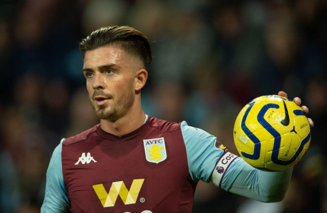 Manchester United transfer target Jack Grealish holds the ball while captaining Aston Villa
