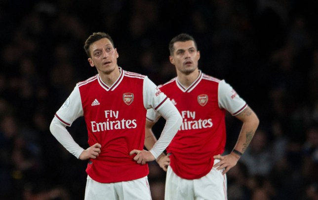 Mesut Ozil and Granit Xhaka look dejected during an Arsenal game