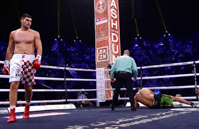 Flip Hrgovic walks away after knocking down Eric Molina in their heavyweight fight on the undercard of Ruiz Jr vs Joshua II