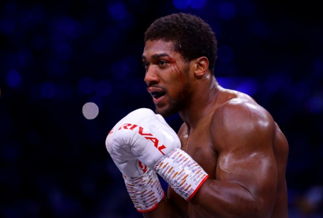 Anthony Joshua is pictured with blood coming down his face during a boxing fight