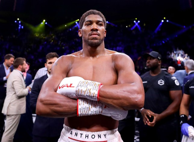Anthony Joshua folds his arms after being confirmed as the winner over Andy Ruiz Jr in their heavyweight rematch