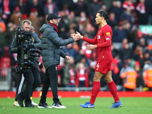 Jurgen Klopp and Virgil van Dijk shake hands after Liverpool's Premier League win over Watford