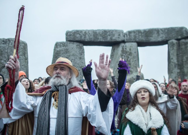 pagans celebrating the solstice at stonehenge