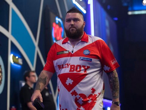Devastated Michael Smith reacts to shock PDC World Darts Championship exit to Luke Woodhouse