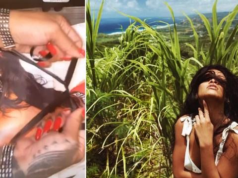 Rihanna is on the naughty list as she demonstrates Savage x Fenty bondage for Christmas