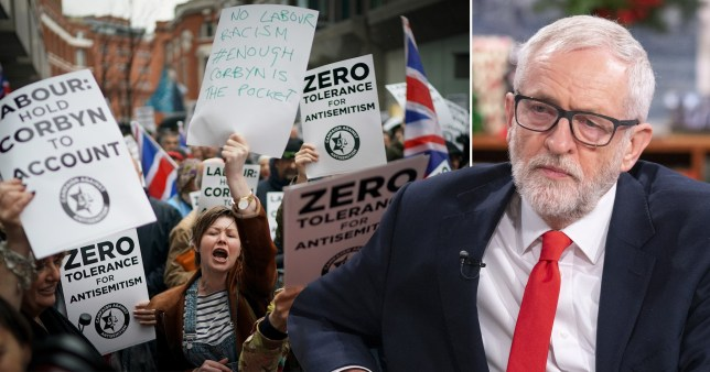 Protesters against anti-Semitism in the Labour party next to a picture of Labour Party leader Jeremy Corbyn