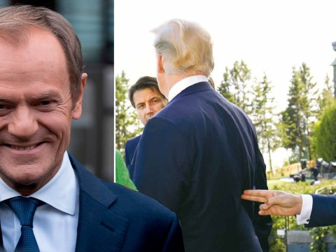 Donald Tusk held his finger gun to Donald Trump's back