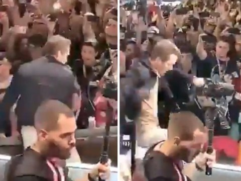 Terrifying moment Ryan Reynolds is almost crushed by stage barrier amid fan chaos in Brazil