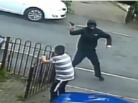 Boy cowers in terror as hooded thugs fire crossbow and gun