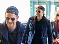 Unlikely pals Bradley Cooper and Anna Wintour make stylish arrival at Heathrow together