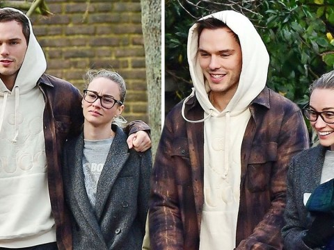 Smiley Nicholas Hoult goes for sweet stroll with girlfriend Bryana Holly as they spend festive season in London