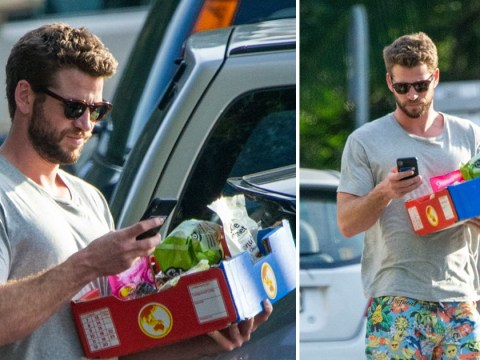 Liam Hemsworth best look out for cars as he focuses on phone after introducing 'girlfriend' Gabriella Brooks to family