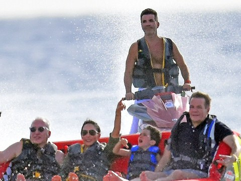 Simon Cowell hits the waves with Lauren Silverman and Eric as they lap up Barbados break