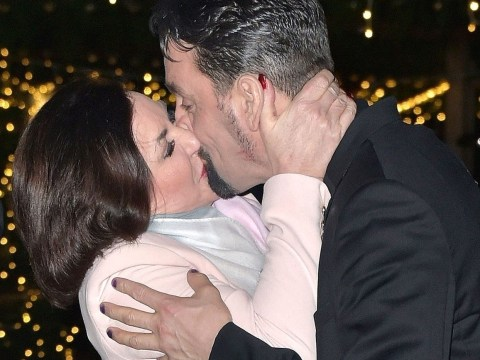 Shirley Ballas and boyfriend Danny Taylor can't take their hands off one another as they pack on the PDA
