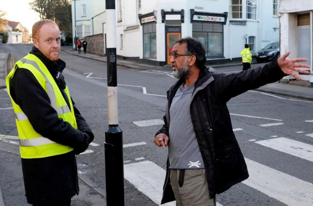 Bobby Sehdev of Monikas shop remonstrates with one of the teachers. A takeaway owner called the police after claims that two teachers were acting like BOUNCERS outside his shop - and giving detentions to any who refused to leave. See SWNS story SWBRtakeaway. Neil D'Souza, owner of Chilli Bellies in Bristol, says he has seen a massive drop in business since staff from Cotham School started patrolling the streets. The school has a policy of policing nearby roads after the end of the day at 2:45pm - and has banned students from entering various businesses before 3:15pm. Officers were called by Mr D'Souza last week when staff allegedly blocked the entrance to his shop and stepped in to boot pupils out. The school has denied teachers entered the premises at all and insisted teachers were simply making sure pupils got home safely.