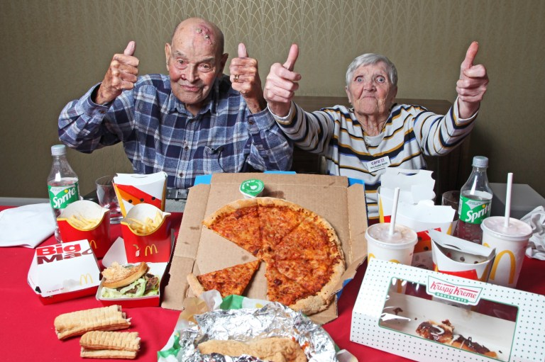 William Thorpe, 99, and Ann Sadler-Smith, 80, from Slough eating food from McDonald's, Greggs, Subway, Domino's, Burger King and Krispy Kreme