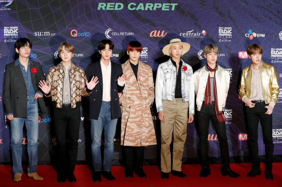 Members of South Korean boy band BTS pose on the red carpet during the annual MAMA Awards at Nagoya Dome in Nagoya, Japan, December 4, 2019. REUTERS/Kim Kyung-Hoon