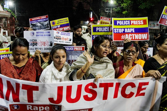 Indians demanding justice in the case of a veterinarian who was gang-raped and killed last week, walk with placards during a protest in Kolkata, India, Wednesday, Dec. 4, 2019. The burned body of the 27-year-old woman was found Thursday morning by a passer-by in an underpass in the southern city of Hyderabad after she went missing the previous night. (AP Photo/Bikas Das)