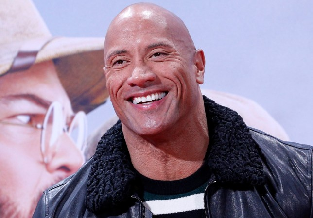 epa08044700 US actor and cast member Dwayne Johnson poses for pictures during the German premiere of 'Jumanji: Next Level' in Berlin, Germany, 04 December 2019. The movie will be released in Germany on 12 December 2019. EPA/FELIPE TRUEBA