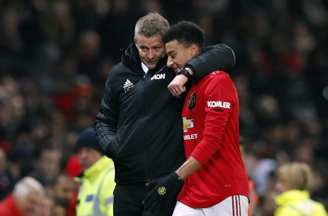 Ole Gunnar Solskjaer wraps his arm around Jesse Lingard after Manchester United's game against Tottenham