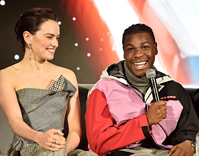 """Daisy Ridley and John Boyega participate in the global press conference for """"Star Wars: The Rise of Skywalker"""" at the Pasadena Convention Center on December 04, 2019 in Pasadena, California."""