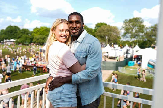 NEW YORK, NEW YORK - MAY 31: (L-R) Iskra Lawrence and Philip Payne during the American Eagle at 2019 New York's Governors Ball at Randall's Island on May 31st 2019 in New York City. (Photo by Gonzalo Marroquin / Getty Images for American Eagle)