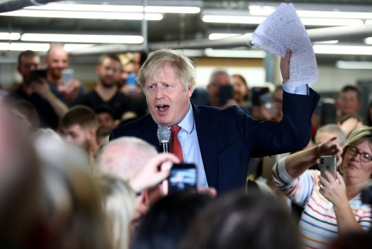 MATLOCK, ENGLAND - DECEMBER 05: UK Prime Minister Boris Johnson delivers a speech during a meeting with workers as he visits John Smedley Mill on December 05, 2019 in Matlock, England. The UK will go to the polls on December 12, the third General Election in less than five years. (Photo by Hannah McKay - WPA Pool/Getty Images)