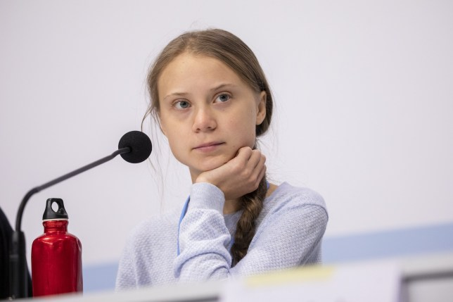 MADRID, SPAIN - DECEMBER 09: Swedish environment activist Greta Thunberg looks on during a press conference with Fridays For Future movement at the COP25 Climate Conference on December 09, 2019 in Madrid, Spain. The COP25 conference brings together world leaders, climate activists, NGOs, indigenous people and others for two weeks in an effort to focus global policy makers on concrete steps for heading off a further rise in global temperatures. (Photo by Pablo Blazquez Dominguez/Getty Images)