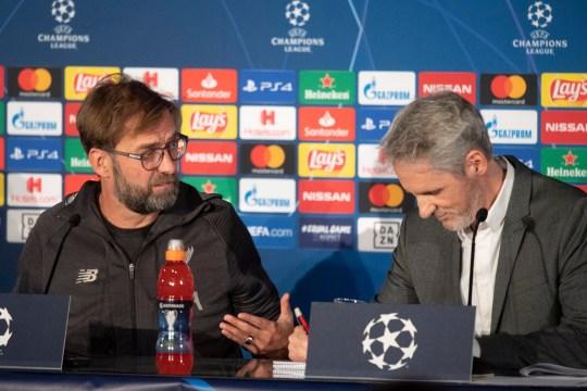 Liverpool boss Jurgen Klopp speaks to the interpreter during a press conferenc