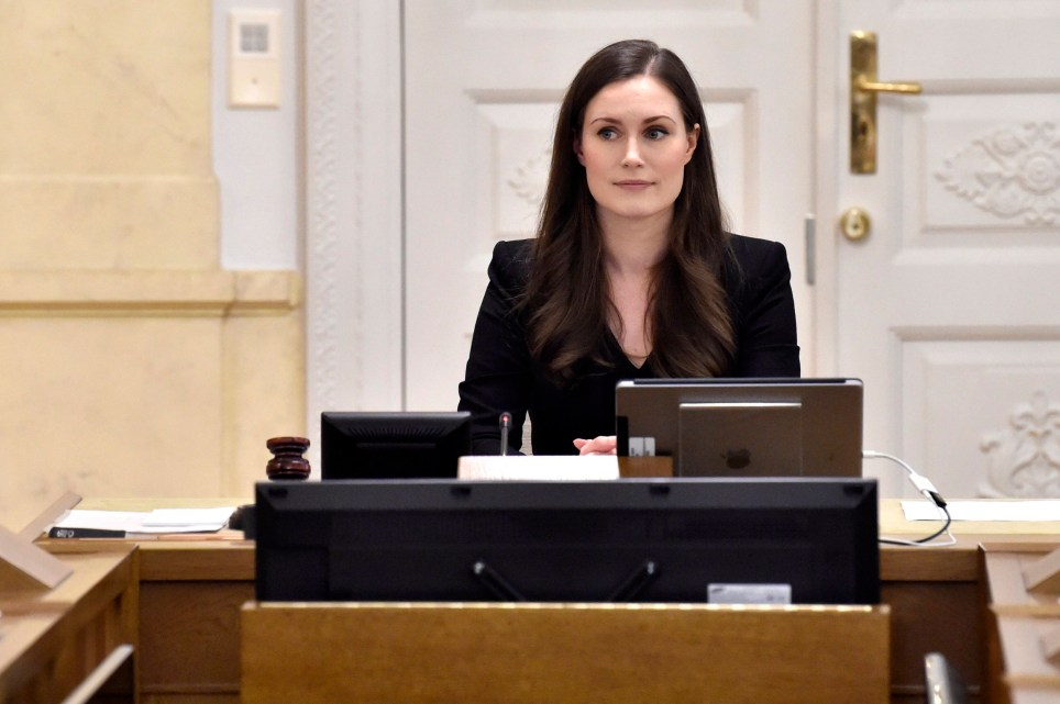 Prime Minister of Finland Sanna Marin, center, chairs her first government meeting in Helsinki, Finland on Tuesday Dec. 10, 2019. Finland???s parliament chose Sanna Marin as the country's new prime minister Tuesday, making the 34-year-old the world???s youngest sitting head of government. (Jussi Nukari/Lehtikuva via AP)