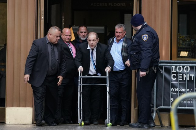Harvey Weinstein(C) leaves Manhattan Criminal Court following a hearing on December 11, 2019 in New York. - The once-powerful film producer, whose case sparked the #MeToo movement against sexual harassment, appeared for a hearing, as his trial looms on January 6, 2010. The 67-year-old, who faces charges of rape and forcibly performing oral sex on a woman, has had his passport confiscated and wears an electronic tracking bracelet. (Photo by Bryan R. Smith / AFP) (Photo by BRYAN R. SMITH/AFP via Getty Images)