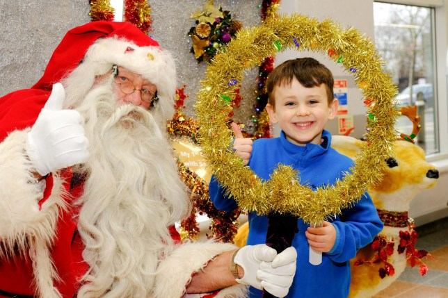 4 year old James Griffin, pictured with Ray Hulse, 75, who has been playing Santa since he was just 18