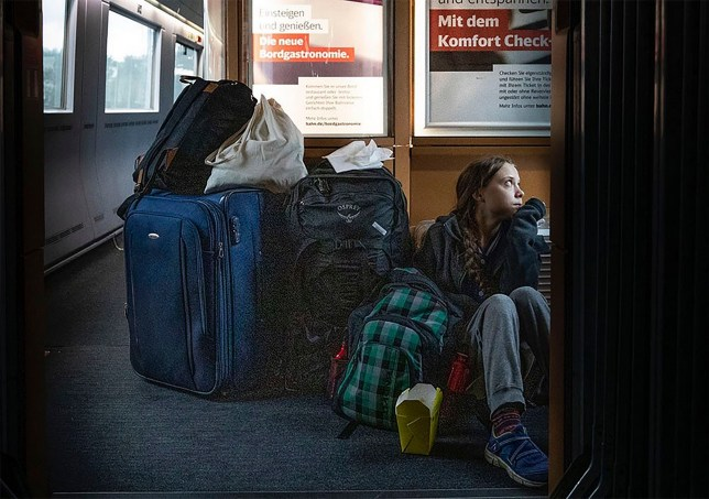 In this image taken from Twitter feed of Climate activist Greta Thunberg, showing Thunberg sitting on the floor of a train surrounded by bags Saturday Dec. 14, 2019, with the comment ???traveling on overcrowded trains through Germany. And I???m finally on my way home!??? The Tweet created a tweetstorm online Sunday about the performance of German railways, but the 16-year-old Swedish activist later sought to draw a line under the matter by tweeting that she eventually got a seat and that overcrowded trains are a good thing showing public transport is popular. (Twitter @GretaThunberg via AP)