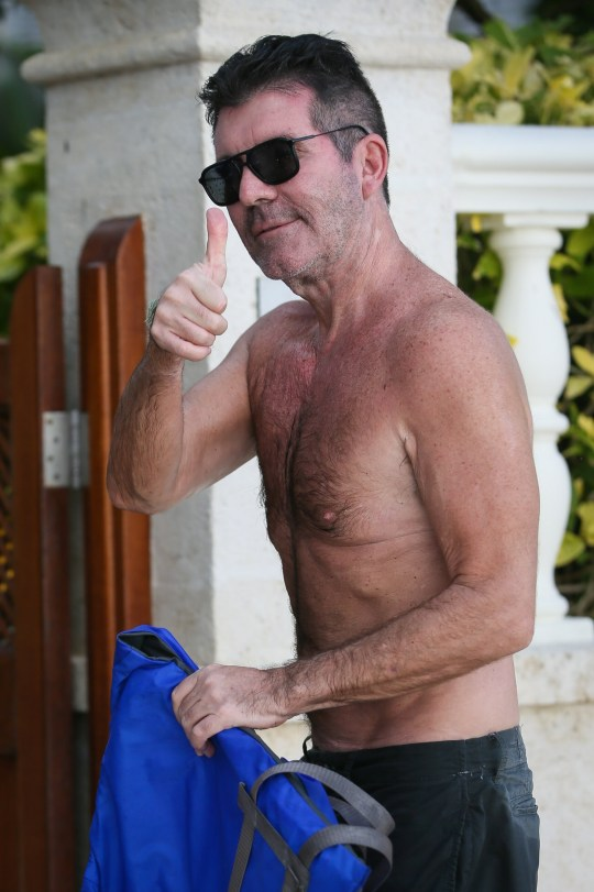 Simon Cowell seen sporting a black eye after taking his sunglasses off on his first day holiday in Barbados - Barbados Pictured: Simon Cowell Ref: SPL5136551 181219 NON-EXCLUSIVE Picture by: SplashNews.com Splash News and Pictures Los Angeles: 310-821-2666 New York: 212-619-2666 London: +44 (0)20 7644 7656 Berlin: +49 175 3764 166 photodesk@splashnews.com World Rights,