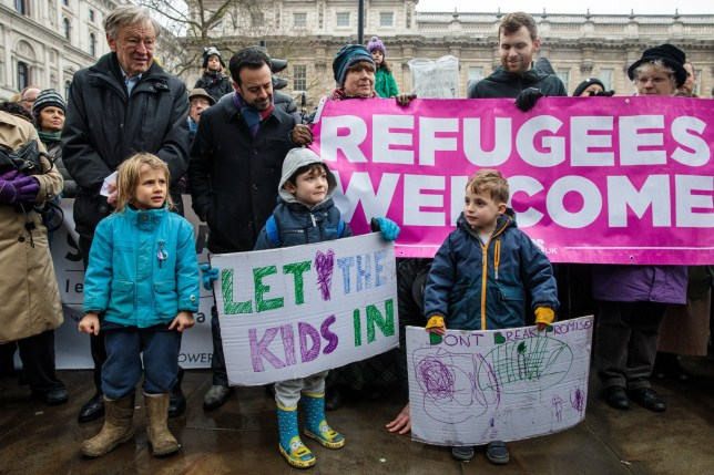 LONDON, ENGLAND - FEBRUARY 11: Lord Alf Dubs (L) is pictured alongside children holding placards during a demonstration on Whitehall calling on the government to take in more child refugees on February 11, 2017 in London, England. Labour Peer Lord Dubs today delivers a petition, signed by 44,434 people, to Number 10 calling on the government to reconsider its decision to end the 'Dubs' scheme, which pledged to take in unaccompanied refugee children into the UK. (Photo by Jack Taylor/Getty Images)