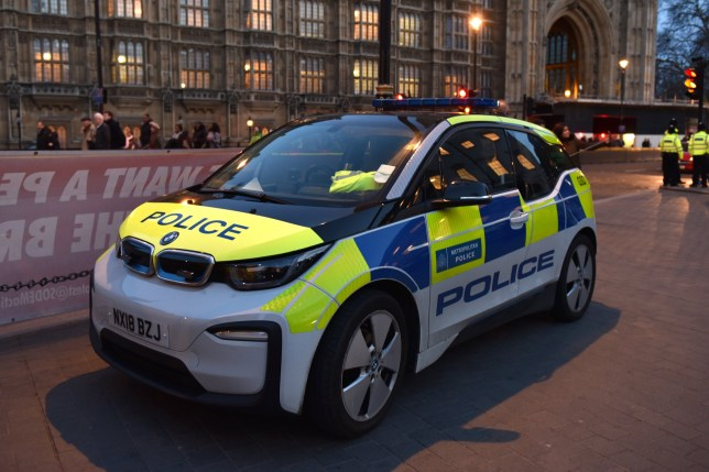 A general view of a BMW i3 all electric zero emission Metropolitan Police car outside the Houses of Parliament on March 14, 2019 in London, England.