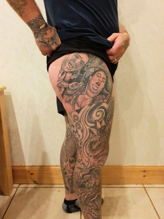 PIC FROM Kennedy News and Media (PICTURED: JAMES MCGRAW, 40, SHOWS OFF ??300 TATTOO HE GOT OF PICTURE OF HIS WIFE KELLY ASLEEP) A mortified mum claims her hubby has 'crossed the line' in their 24-year prank battle - by TATTOOING a 'horrific' photo of her snoring with her mouth open on his BUM. Dad-of-five James McGraw plotted the ultimate revenge prank after his wife Kelly left him with a dodgy haircut ahead of his holiday with pals as a joke. So the 40-year-old window cleaner decided to get his wife a Christmas present to remember by getting her face tattooed on his bum cheek. SEE KENNEDY NEWS COPY - 0161 697 4266