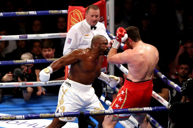 Dereck Chisora punches David Price and traps him against the ropes in their heavyweight fight