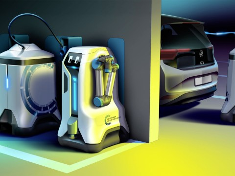 Volkswagen's friendly-faced robots will charge up electric cars while they're parked