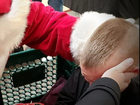 Heartwarming moment department store Santa Claus calms boy, 8, with autism