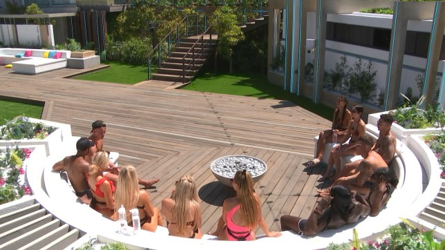 The Islanders sit around the firepit in the villa on Love Island.