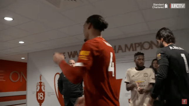 Fred waits in tunnel after Manchester United's loss to swap shirts with Liverpool keeper Alisson